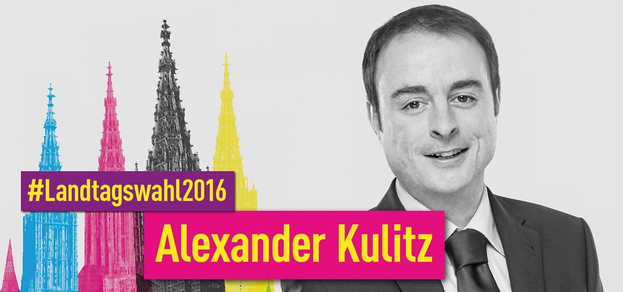 Alexander Kulitz für die Landtagswahl 2016 vor dem Münster, dass in blau, rot und gelb dargestellt wird
