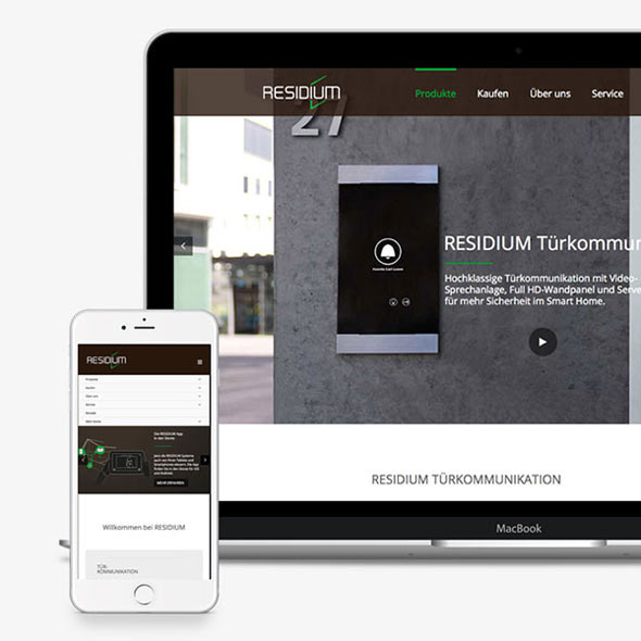 Ein Smartphone und ein iMac zeigen die responsive Website von Residium