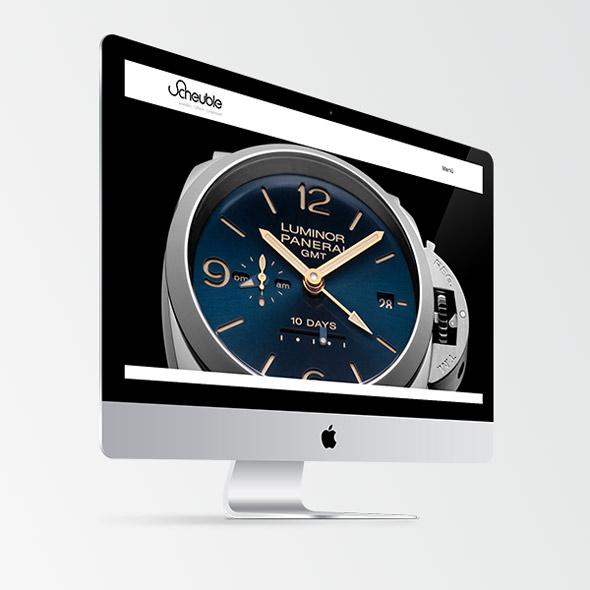 Die neue responsive Website von Scheuble Uhren auf einem iMac mit einer Großen Uhr als Headerbild