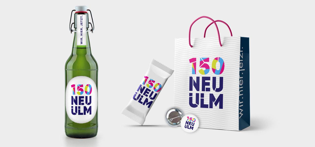 Bierflasche, Müsliriegel, Aufkleber und Tragetasche mit dem entworfenfen Logo 150 Jahre Neu Ulm
