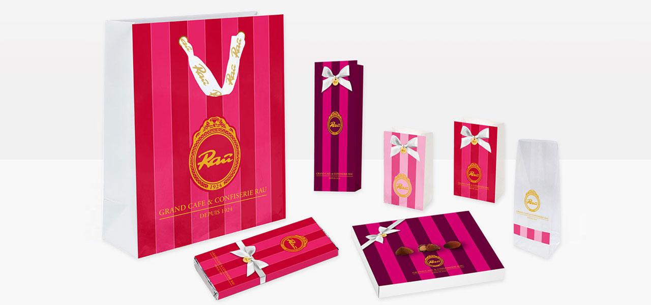 Entwürfe von Tüten und Verpackungen für das Grand Cafße & Confisserie Rau